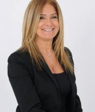 Anastasia Tsingelis, Courtier immobilier