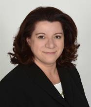 Liz Laki, Courtier immobilier