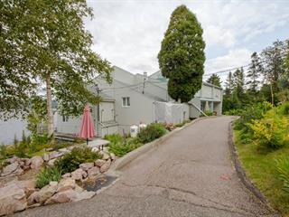 Bâtisse commerciale à vendre à Saguenay (La Baie), Saguenay/Lac-Saint-Jean, 9122 - 9124, Chemin de la Batture, 14809676 - Centris.ca