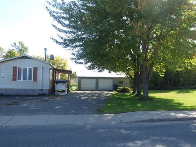 Maison mobile à vendre à Odanak, Centre-du-Québec, 1101, Rue  Awassos, 28041183 - Centris.ca