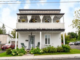 Duplex à vendre à Laval (Sainte-Rose), Laval, 33 - 35, Rue  Émile-Léonard, 27618261 - Centris.ca