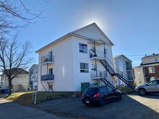 Triplex à vendre à Rivière-du-Loup, Bas-Saint-Laurent, 113, Rue  Fraserville, 12126757 - Centris.ca