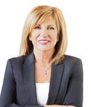 Catherine Papachristou, Certified Residential and Commercial Real Estate Broker AEO