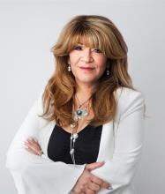 Carmen Deligia, Courtier immobilier