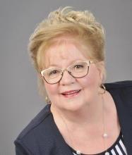 Claudette St-Onge, Courtier immobilier