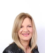 Pam Nikolopoulos, Courtier immobilier