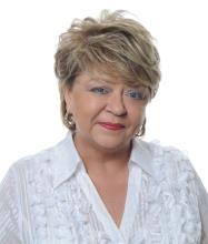 Janice Newton, Courtier immobilier