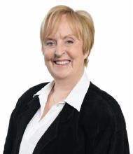 Carmen Doré, Courtier immobilier