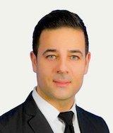 George Mouzakiotis, Courtier immobilier